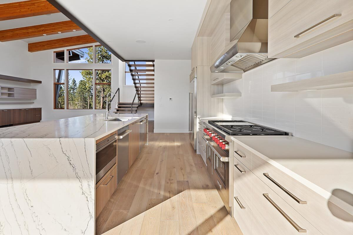 Going back to the kitchen, the hardwood flooring matches the light wood cabinetry for a seamless look.