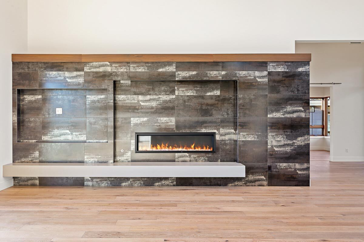 A modern fireplace creates a focal point in the living room.