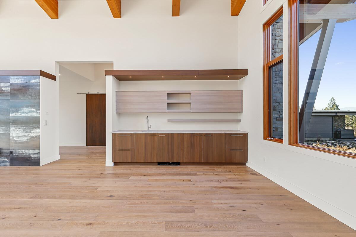The dining area includes a wet bar with custom wood cabinetry and a marble countertop.