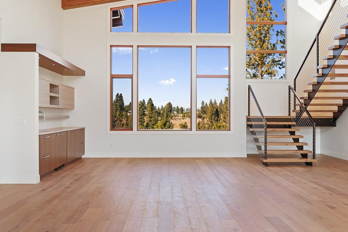Clerestory windows and wide plank flooring complete the dining room.
