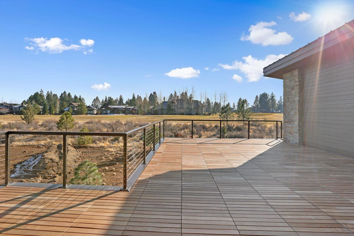 The open deck has an expansive view of the serene surrounding.