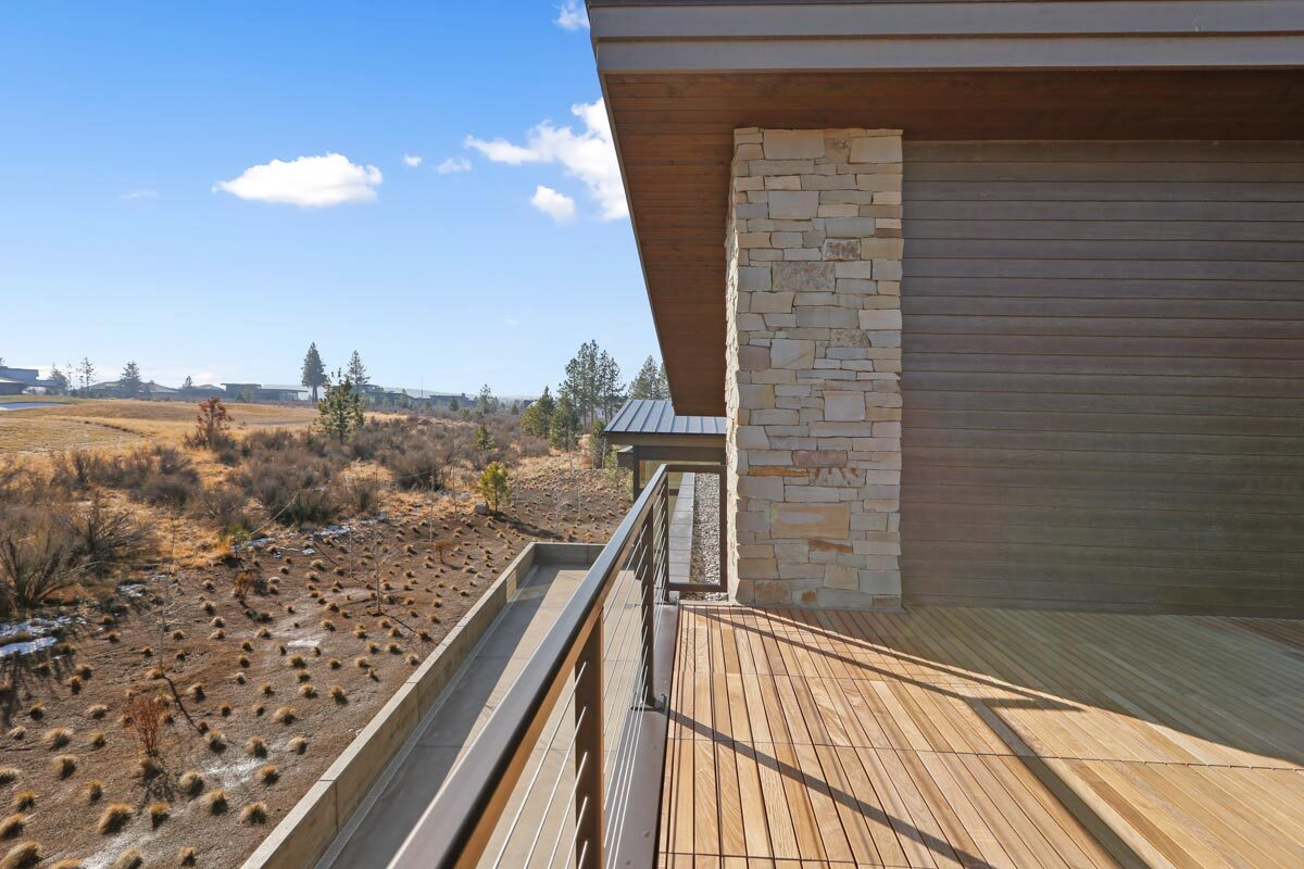 The open deck looks down the rear patio as well.