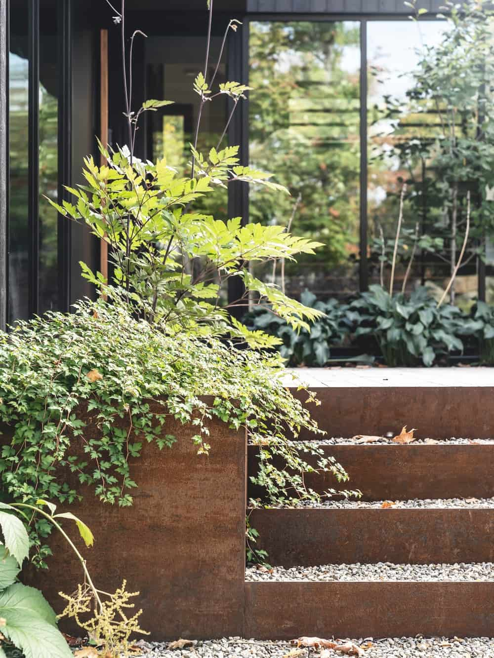 This is a close look at the planters and landscaping at the side of the concrete steps.