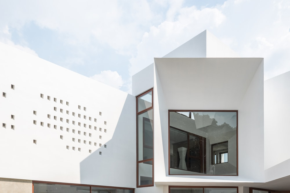 You can also see here the unique design of the house with two different windows having different angle facing.
