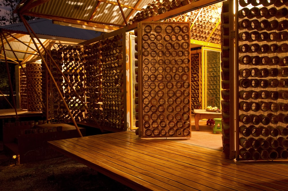 This nighttime view of the house exterior showcases the warm lighting of the interior that passes through the bamboo panels.
