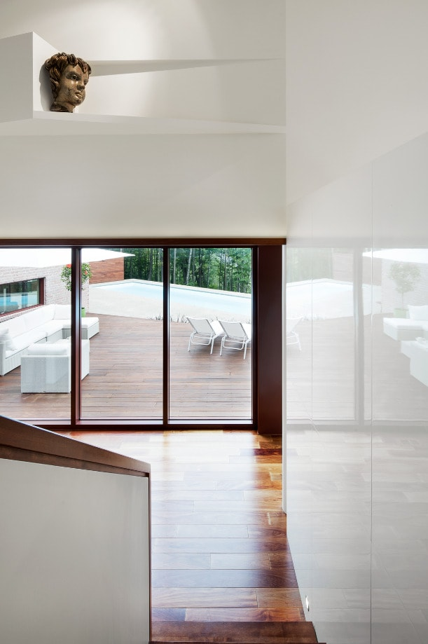 This is a look at the interior of the house from the vantage of the landing looking down at the hardwood flooring.
