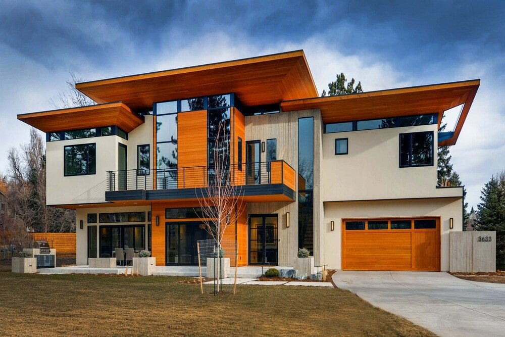 This is an exterior look at the front of the house that has wooden elements, as well as glass and beige exterior walls.