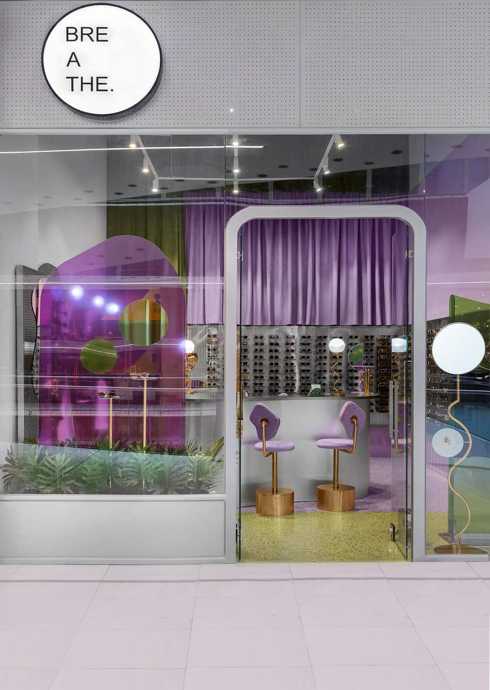 This is a view of the whole shop from outside showcasing more of the glass walls and the brilliants colors of the interiors.