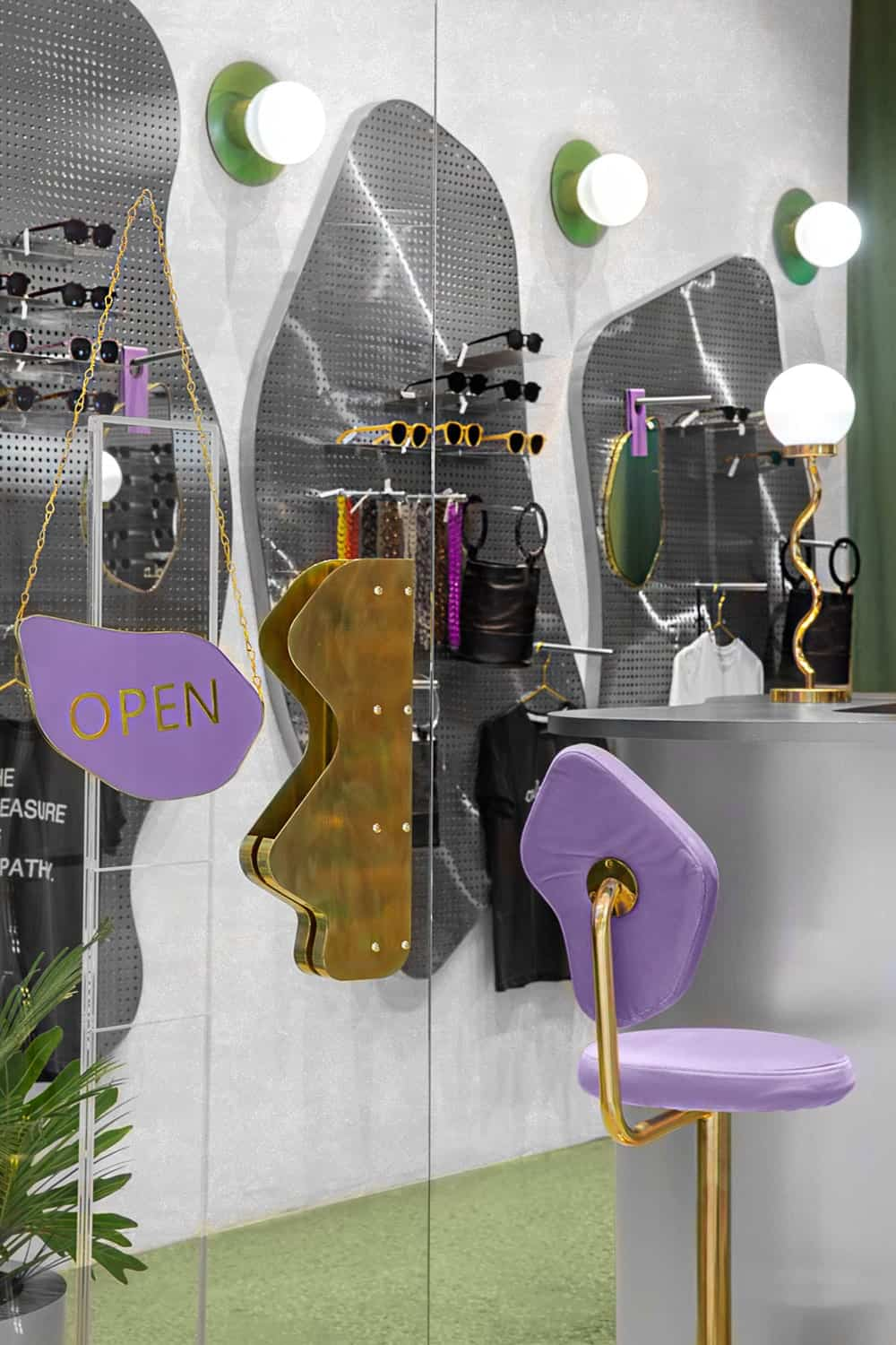 This view of the shop showcases the purple customer's chair and the glass door with a unique handle and sign.