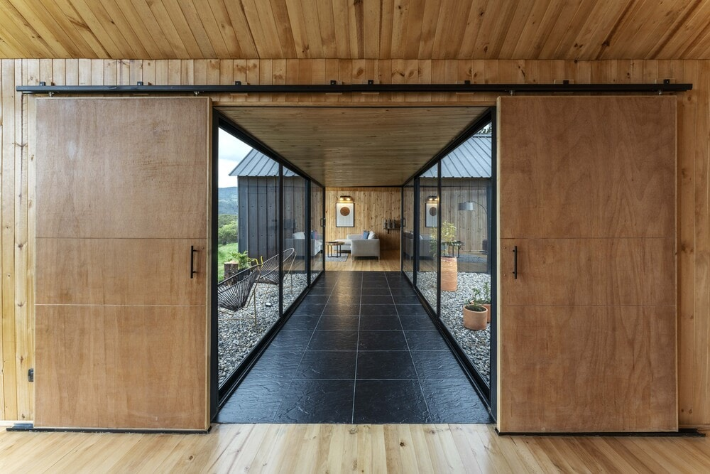 This bright hallway connects the two large open sections of the house.