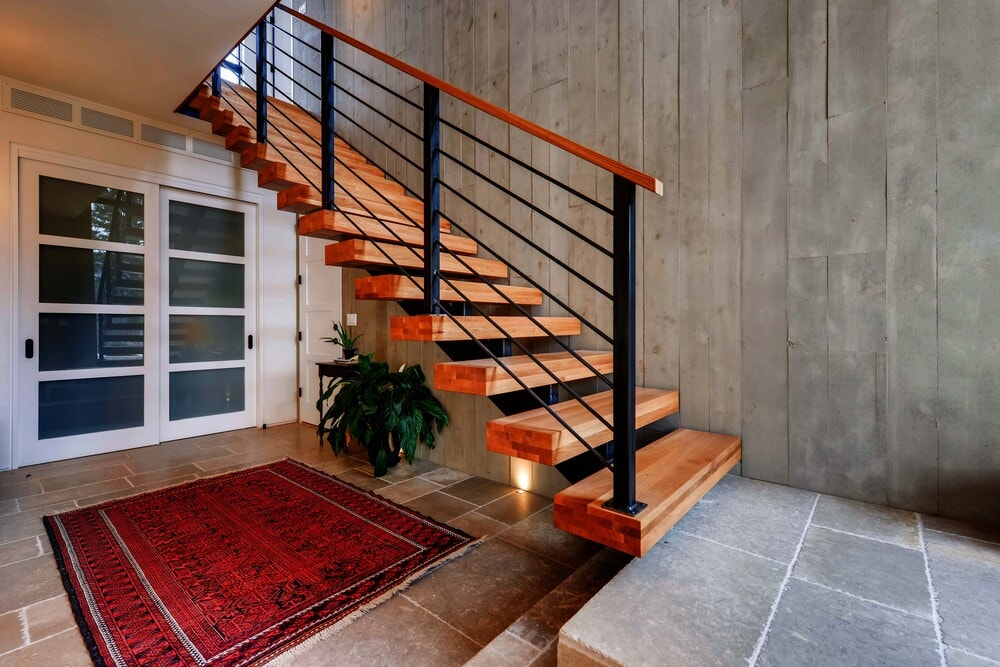 This is another close look at the staircase with its metal railings that match the metal beam that supports the wooden steps.