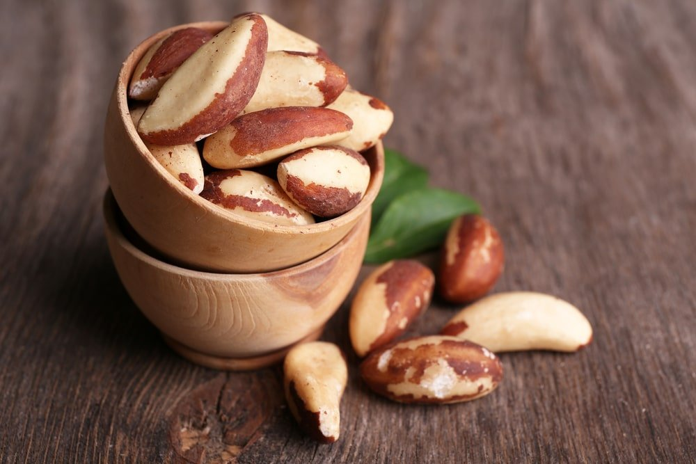 Brazil nuts on stacked bowls.