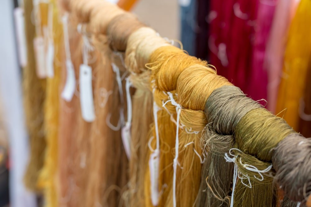Cotton bundles that are dyed and displayed.