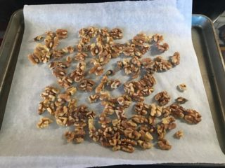 The walnuts are baked on a sheet.