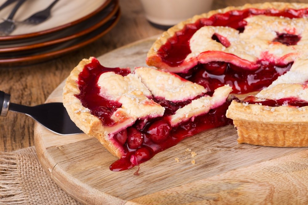 Taking a slice of cherry pie.