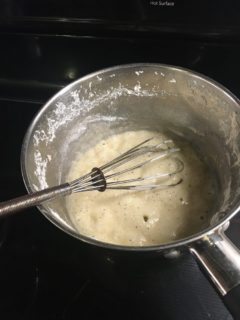 Butter, garlic and flour are cooked in a saucepan.