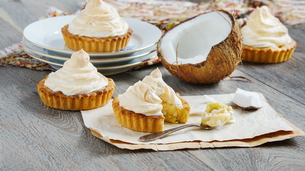 Tarts with coconut cream and meringue.