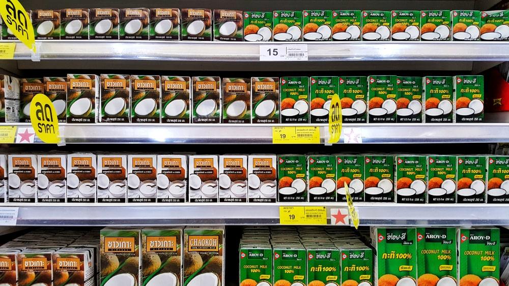 Coconut milk boxes display in supermarket.