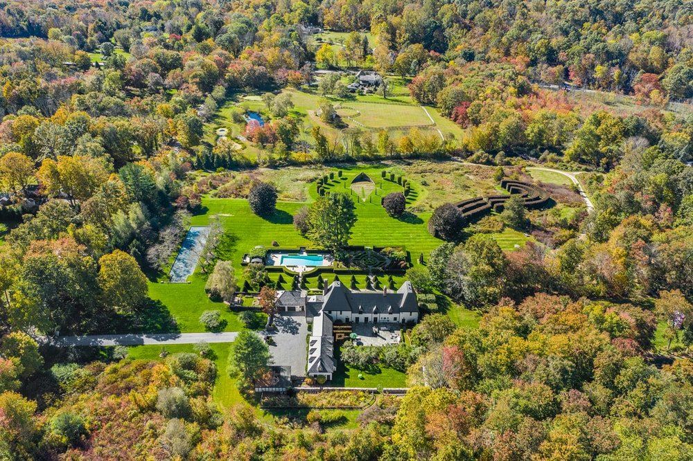 This is an aerial view of the large property showcasing the large house surrounded by the surrounding landscape. Image courtesy of Toptenrealestatedeals.com.