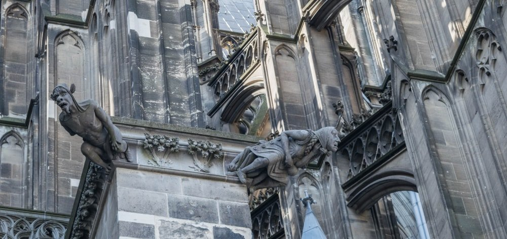 This is a close look at the exterior gargoyle details of a gothic church.