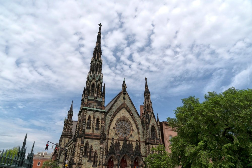 This is a close look at a gothic-style church with an asymmetrical design.