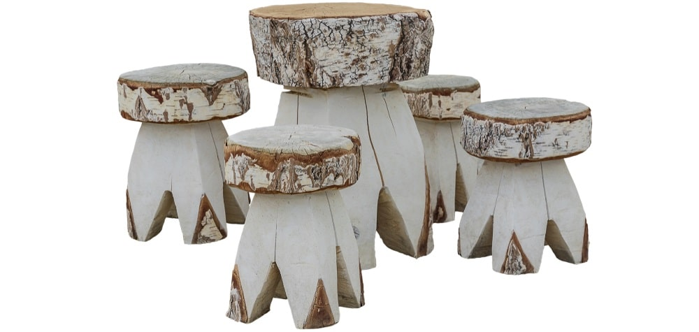 A set of rustic wooden chairs and table made from a birch tree.