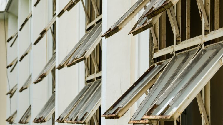 This is a close look at a building with hopper windows.
