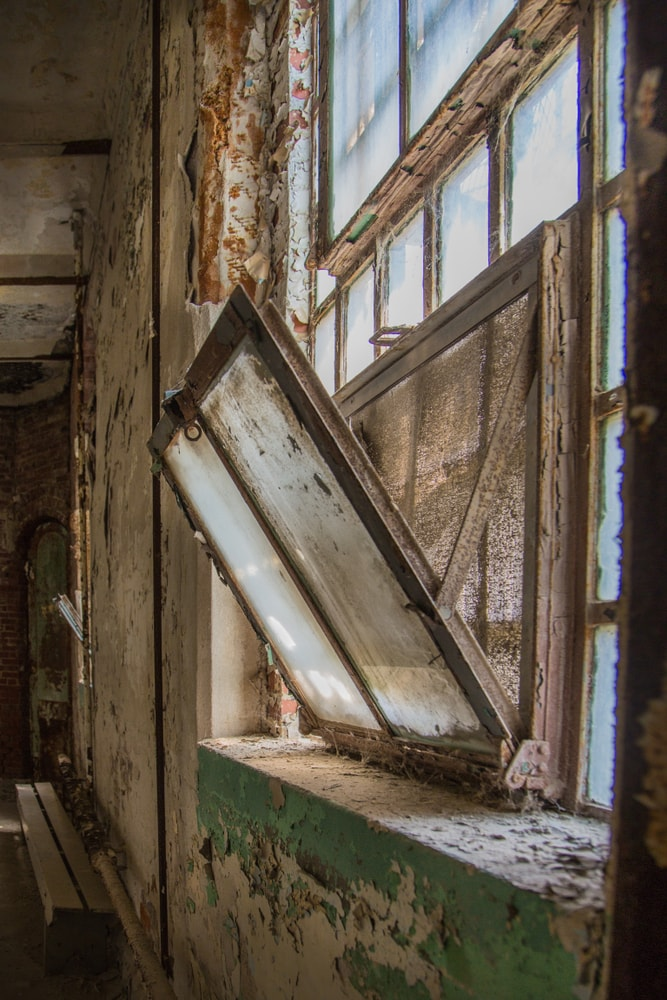 This is a look at an old warehouse with a hopper window.