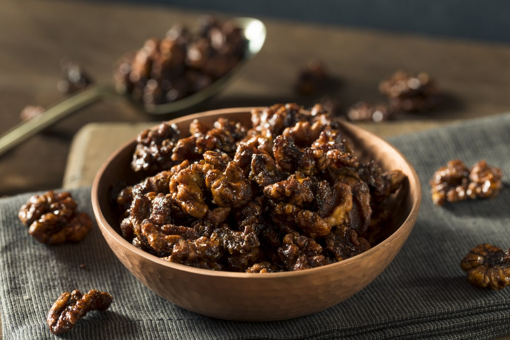 This is a close look at a bowl of appetizing candied walnuts.