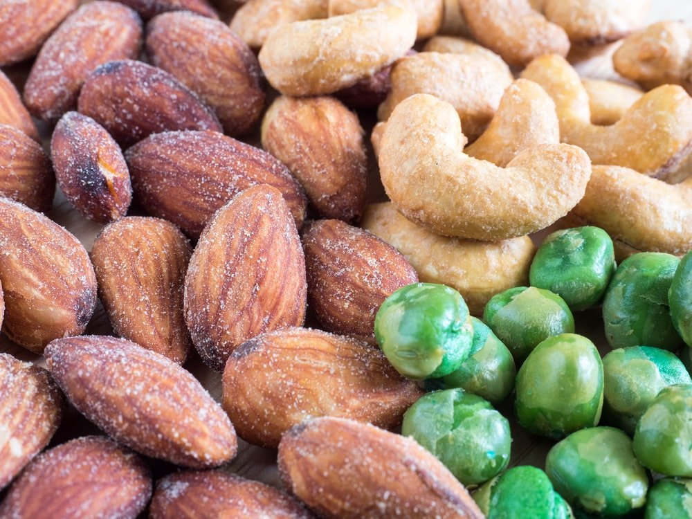 A close look at walnuts, cashew and green peas.