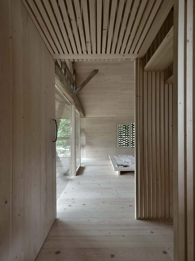 Upon entry, you are welcomed by this simple wooden foyer with a consistent wooden tone to its floor, walls and ceiling.
