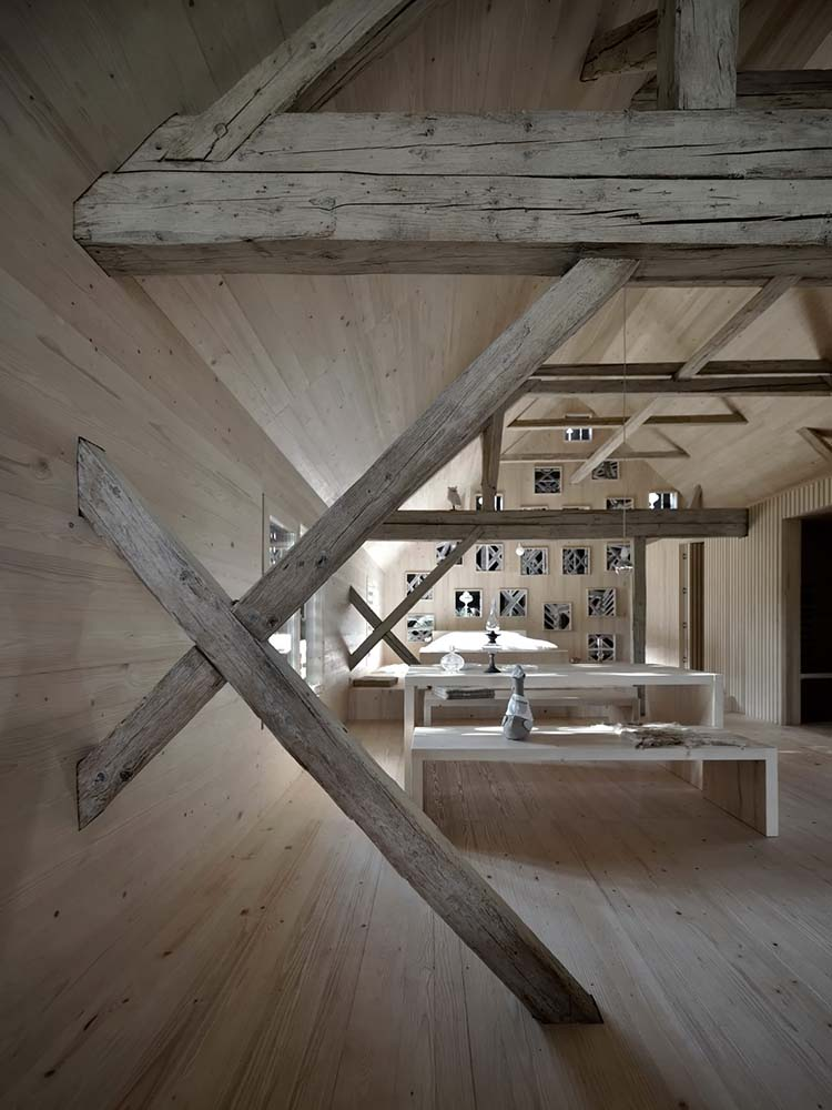 This is a look at the great room that has exposed support beams on the ceiling and walls giving it a unique look.