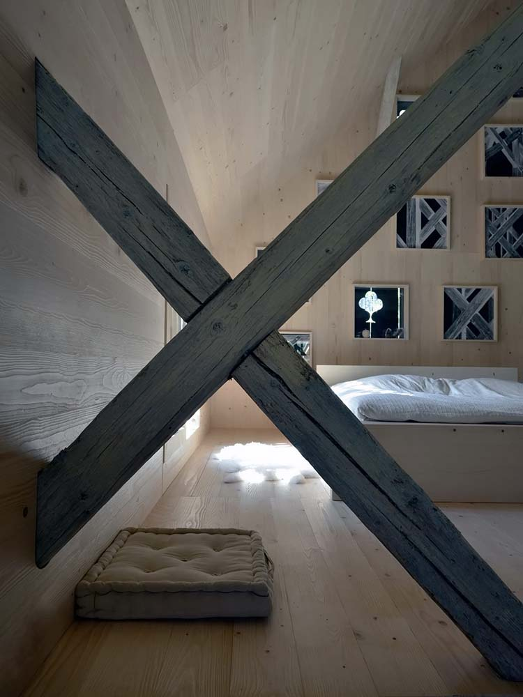 This is a close look at the bedroom area beyond the wooden beam of the dining area.