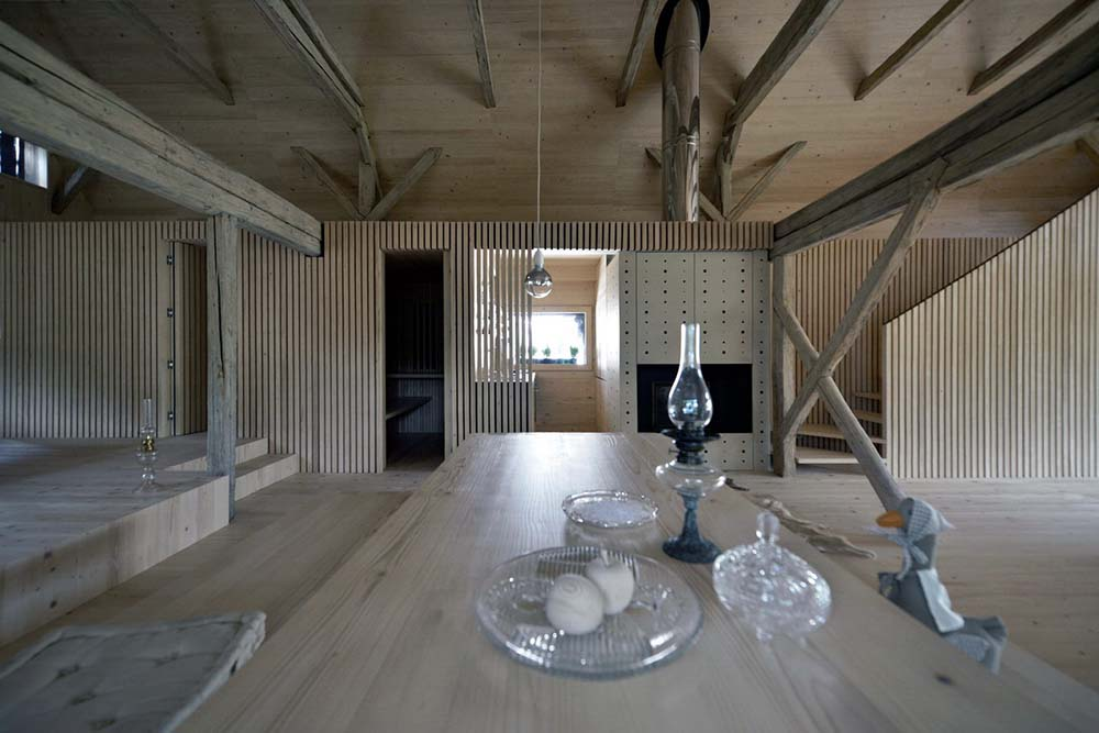 This view of the house showcases more of the tall ceiling and its exposed wooden beams.