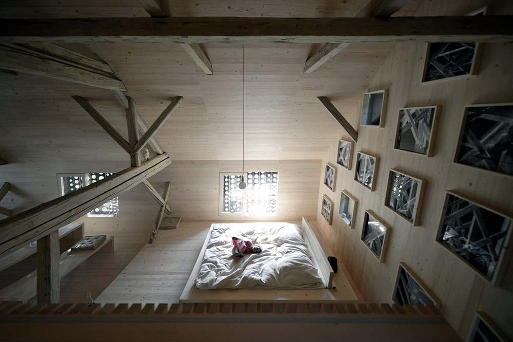 This is a top view of the bright platform bed from the vantage of the indoor balcony.