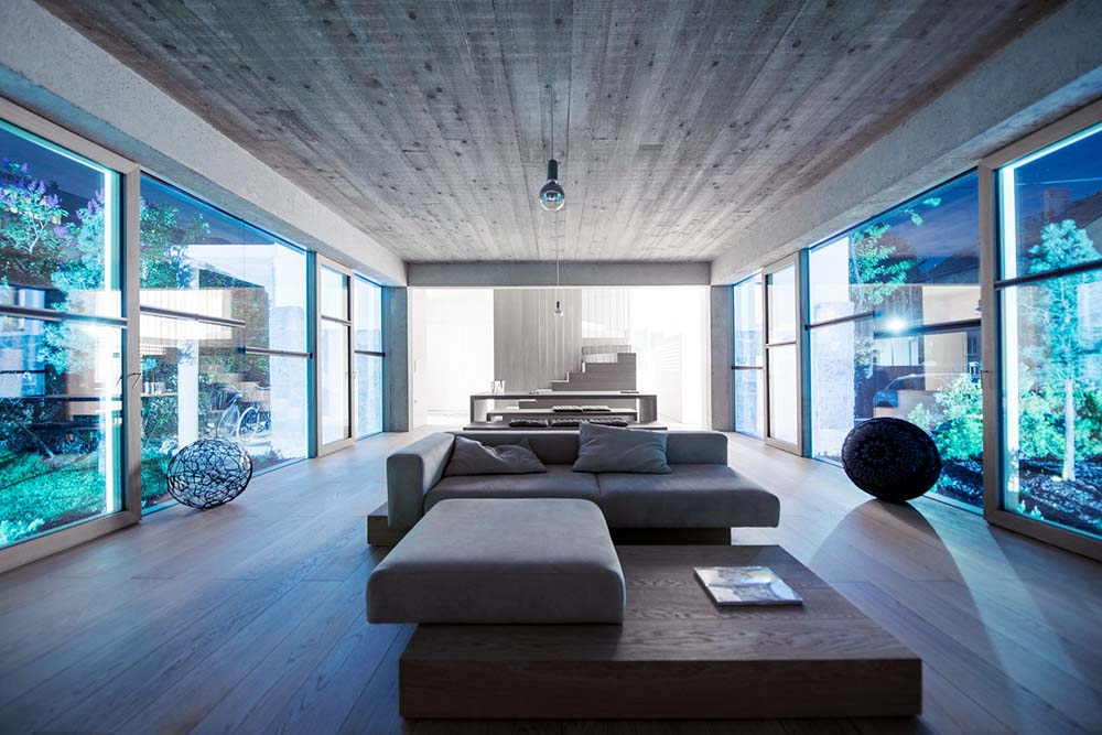 This living room area is brightened by the glass walls on both sides.