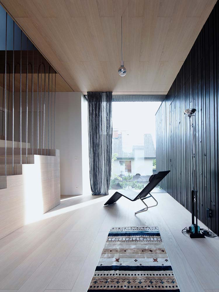 The flooring blends well with the wooden steps of the staircase and the ceiling.
