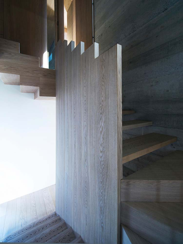 This is a close look at the wooden wall in the middle of the staircase.