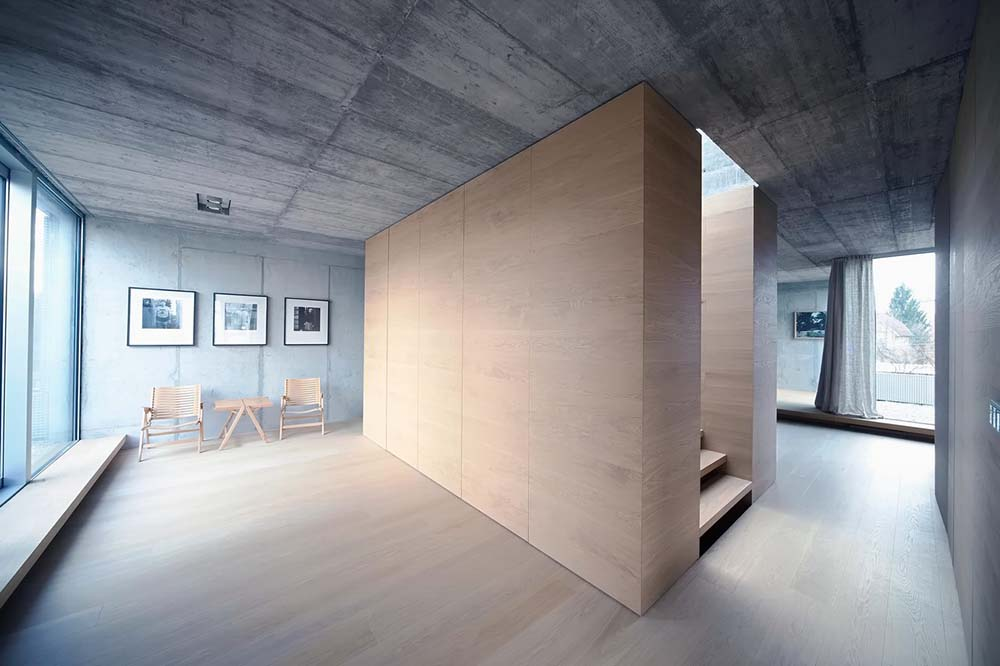 This is another look at the large wooden walls of the staircase that matches the light hardwood flooring.