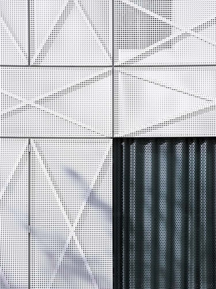 This is a closer look at the panels of the house exterior with criss cross structures within it.