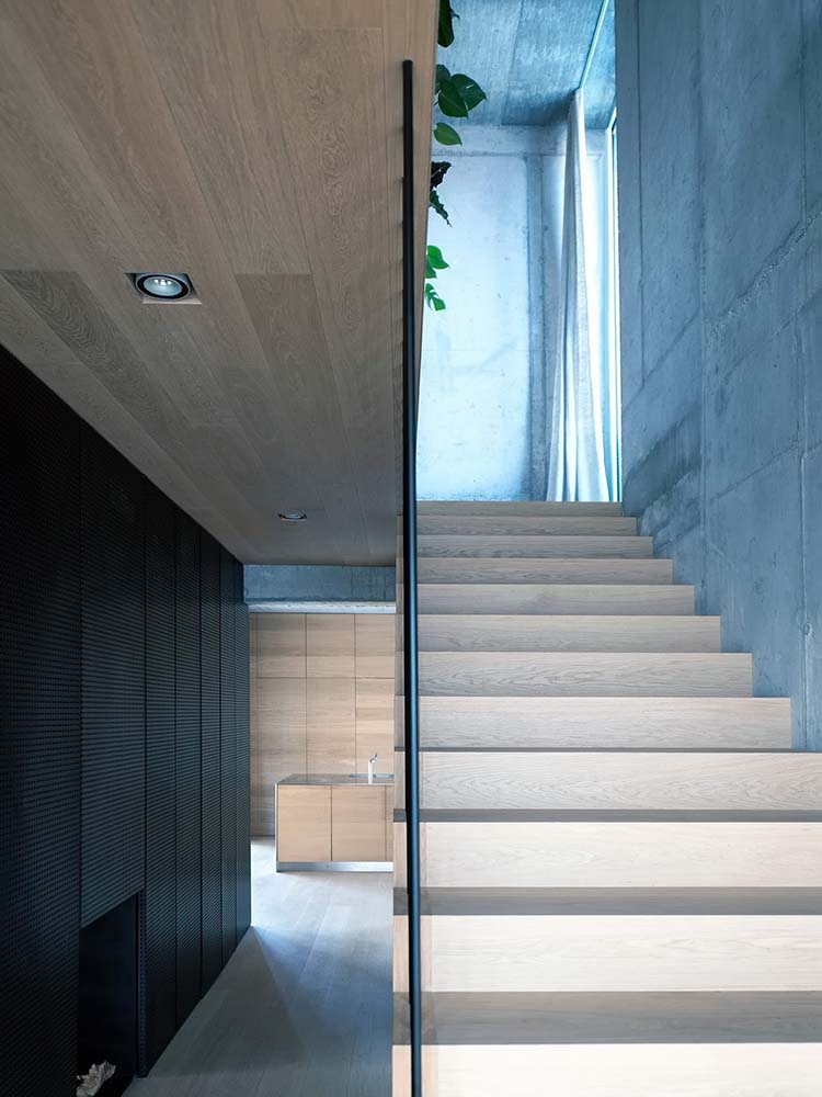 This is a close look at the wooden steps of the stairs that match with the ceiling.