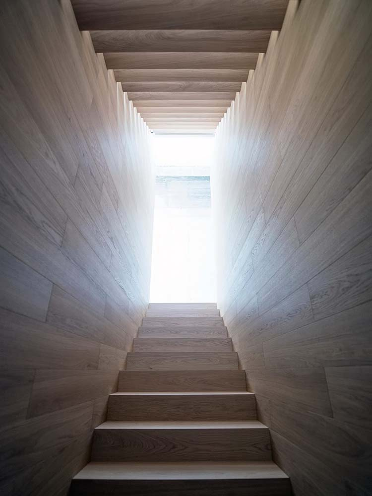 This is a look at the bright upper landing of the staircase from the vantage of the foot of the stairs.