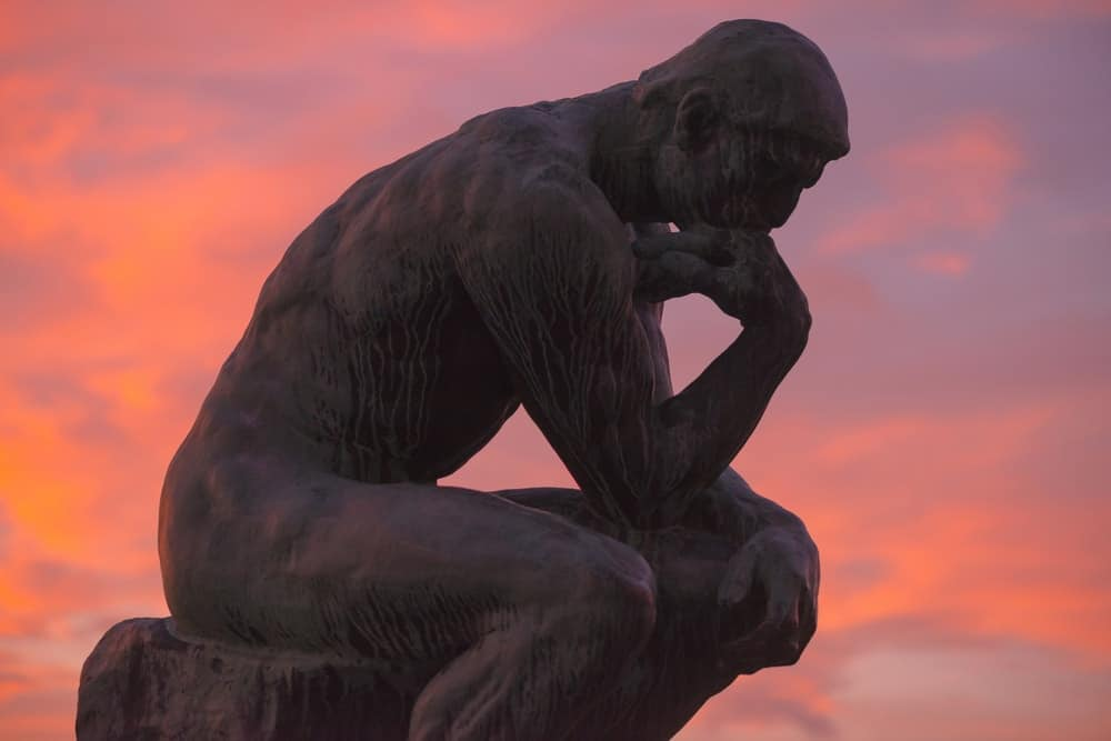 This is the Sculpture of the thinker of Rodin at Waldermarsudde in sunset light.
