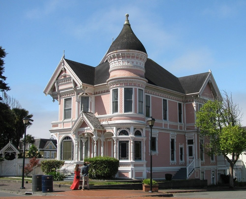 This is a look at the pink house that has a Queen Anne Architecture.