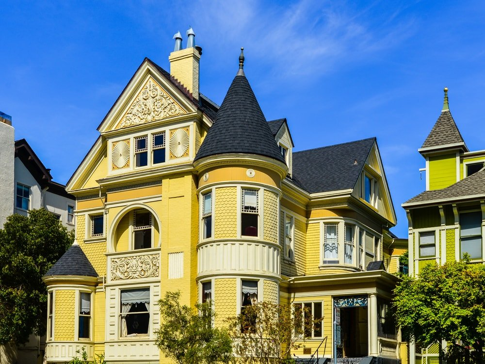 This is a Queen Anne Victorian home with yellow exterior walls.