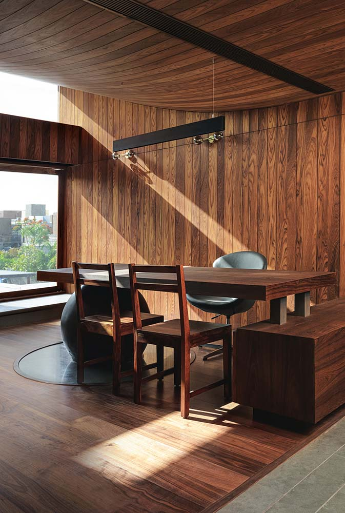 This is the home office with a built-in wooden desk that matches the tone of the wooden walls and ceiling.