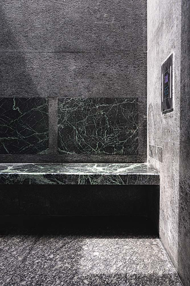 This is a close look at the built-in marble bench within the shower area of the bathroom.