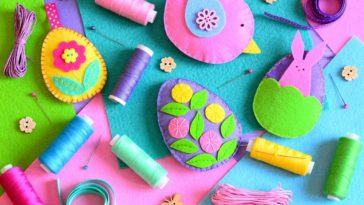 A close look at colorful felt easter eggs and sewing accessories.