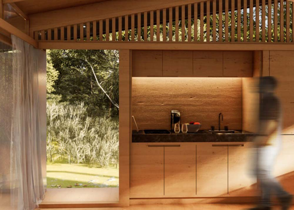 This is the kitchenette of the house with wooden cabinetry that matches with the rest of the interior structures.