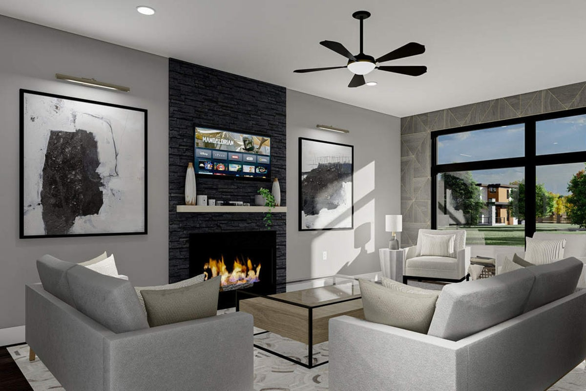 Living room with gray modern seats, a glass top coffee table, and a fireplace topped with a wall-mounted TV.